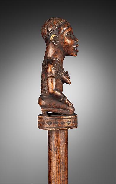 Staff : Finial with Kneeling Female Figure