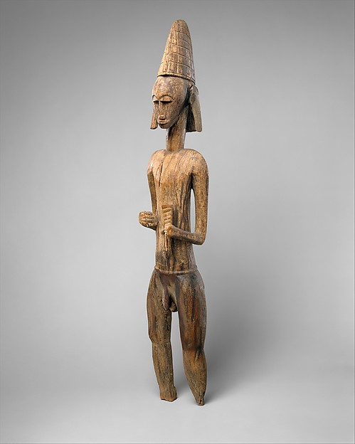 Male Figure Holding Animal Horn
