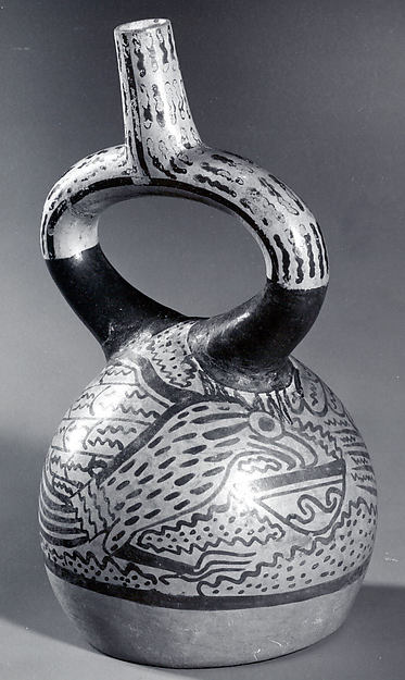 Stirrup spout bottle with hawk
