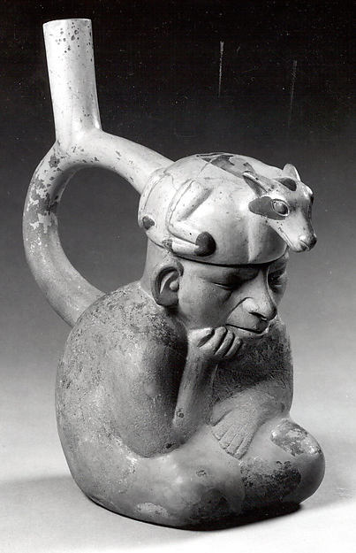 Stirrup spout bottle with figure with llama headdress
