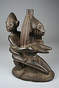 Vessel Support: Kneeling Mother with Child Figure