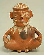 Stirrup Spout Bottle with Seated Figure