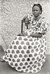 Young Woman Seated in Apple Print Dress