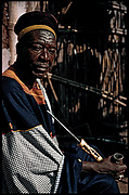 Portrait of Fon Nsom (r. 196675) holding a prestige pipe in brass and ivory