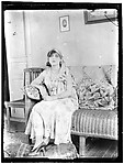 Woman on a Rattan Sofa, Indoors