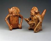 Pair of Figure Vessels