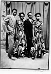Untitled [Two Unidentified Couples. Women in Same Dress]