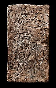 Brick Depicting a West Asian Merchant Wearing a Kupeeyok Hat