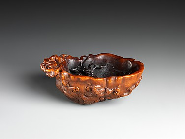 Cup with two dragons in waves