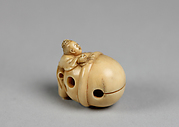 Netsuke in the form of a Bell with a Boy