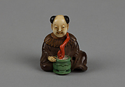 Netsuke of Seated Man with a Flower Pot