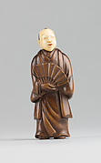 Netsuke of Figure with an Ivory Head