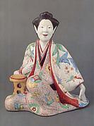 Figure of a Seated Beauty