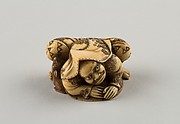 Netsuke of a Hunter Trying to Catch a Fox Beneath a Straw Hat
