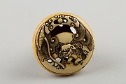 Netsuke Carved with Shishi; reverse with Lotus Leaf