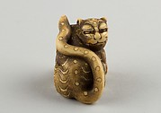 Netsuke of Seated Tiger with a Curled-up Tail Across its Back