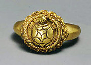 Ring with Tortoise Motif on Circular Bezel