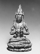 Seated Male Deity Holding Two Ritual Objects