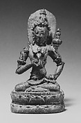 Seated Male Deity Holding a Double Vajra