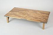 Table with Design of Pine and Plum Trees