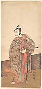 The Actor Ichikawa Danjuro V standing inside of a house and in front of an engawa