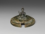Lid with Seated Male Figure