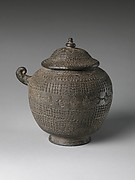 Covered urn with geometric decoration