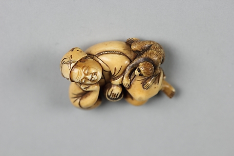 Netsuke of Sleeping Man and a Monkey