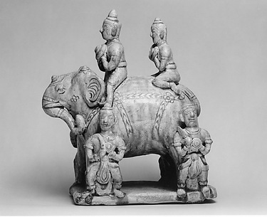 Elephant with Two Riders and Four Grooms