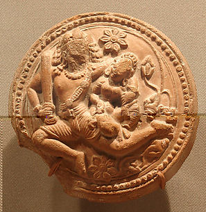 Rondel with a Racing Male Deity Cradling His Consort (Probably Shiva and Parvati)
