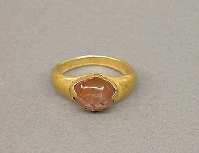 Ring with Inset of Opal Colored Stone