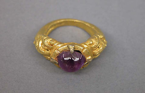 Ring with Inset Purple Oval-shaped Stone