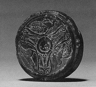Disk Stone with a Three-Part Design of Palmettes and Birds