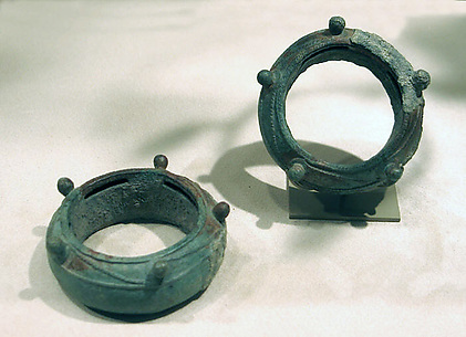 One of a Pair of Pellet Bangles with Textile Remnants