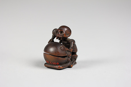 Netsuke of Skeleton with a Beating a Drum