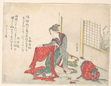 Woman Folding Cloth