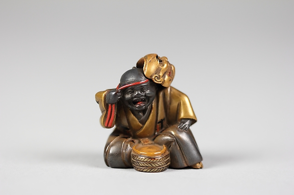 Netsuke of Boy with a Mask