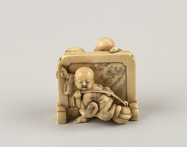 Netsuke of Three Boys Playing around a Screen