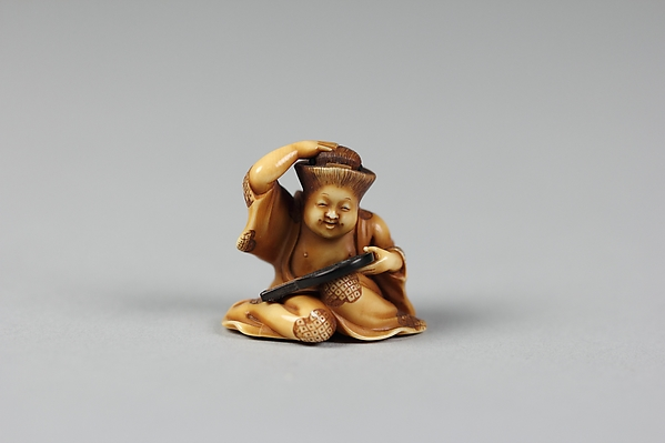 Netsuke of Girl at her Toilet