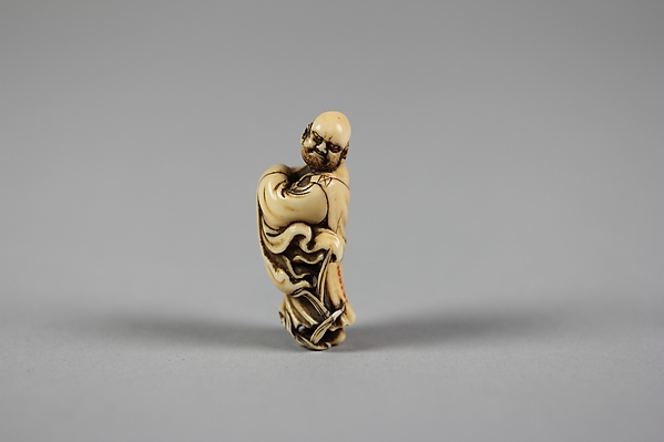 Netsuke of Daruma Crossing the Yangzi River on a Reed