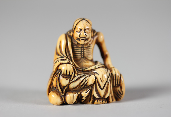 Netsuke of Old Man Seated on a Rock