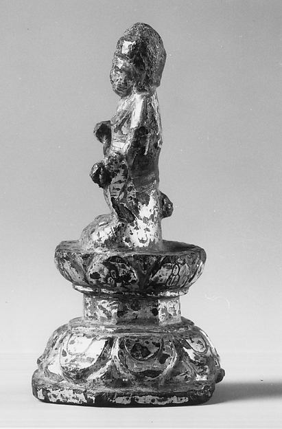 Statuette of Buddha Sitting on Engraved Throne