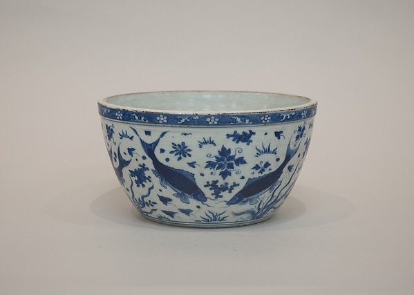 Bowl with fish in pond