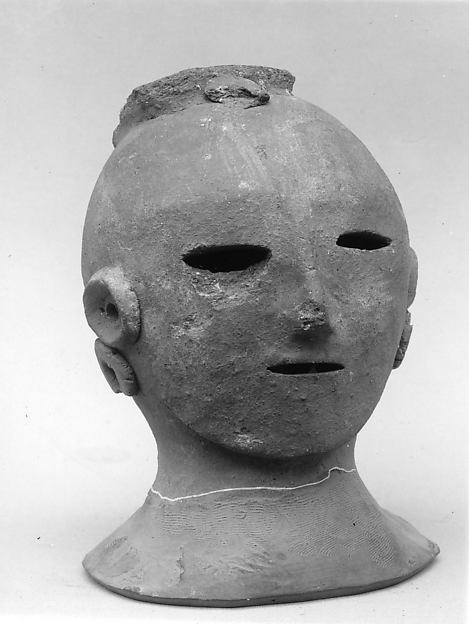 Head of a Female Haniwa Figure with Headdress and Earrings