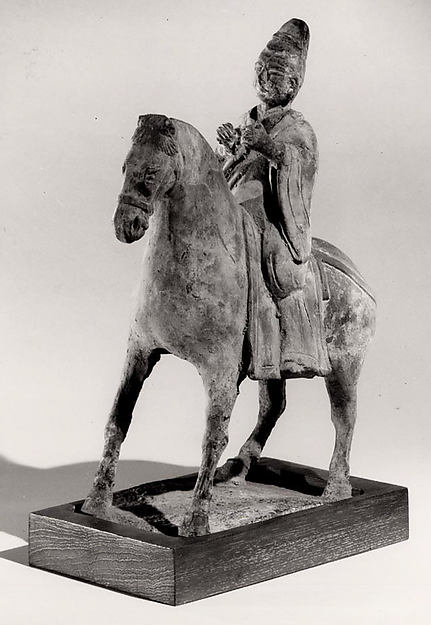 Official on Horseback