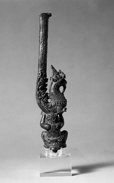 Yaksha Supporting a Naga