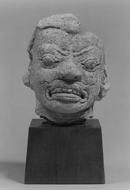 Head of a Grimacing Male Deity