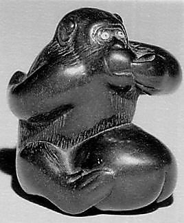 Netsuke of Monkey with One Hand over Mouth, the Other Behind His Back