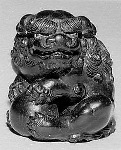 Netsuke of Seated Shishi Clutching a Ball