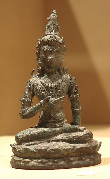 Seated Male Deity Holding a Manuscript(?)